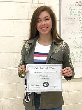 girl holding certificate smiling