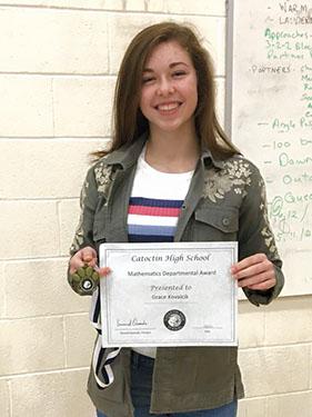 girl holding certificate smiling