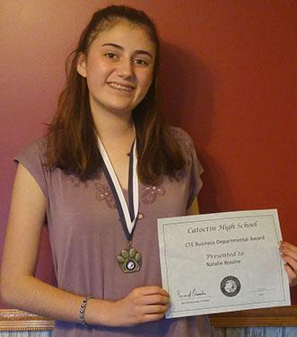 smiling girl holding award