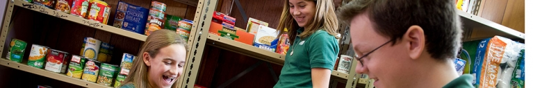 students smiling at food bank